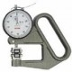 Thickness gage for moving film